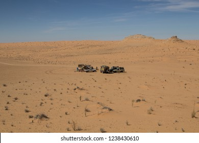 Camp in the sand with off road vehicles in the western Sahara in Tunisia