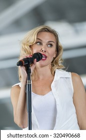 CAMP SPRINGS, MD, USA - SEPTEMBER 19, 2015: Laura Bell Bundy performs during the 2015 Joint Base Andrews Air Show held at Joint Base Andrews in Camp Springs Maryland.