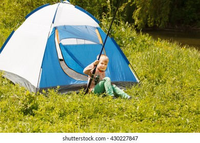 Camp in the tent -boy on the camping