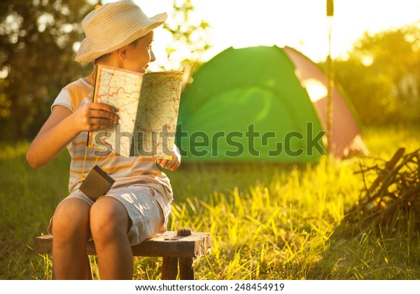 Camp in the tent - young boy on a camping