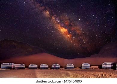 A camp in Wadi Rum desert at night with milky way, Jordan.