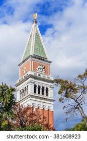 Campanile church tower, Venice, Italy from Riva degli Schiavoni over treetops