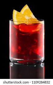 Campari and tonic in Rocks glass isolated on black