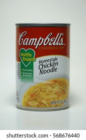 Campbells Chicken Noodle soup can.  Isolated product vertical frame shot condensed homestyle meal label artwork designed by Andy Warhol - Illustrative editorial.