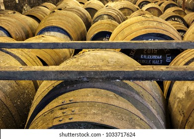 CAMPBELTOWN, SCOTLAND - SEPT 15 2017 : Old wooden barrels and casks at Springbank whisky distillery est. in 1828 owned by J&A Mitchell and Co, situated at the southern end of the Kintyre Peninsula.