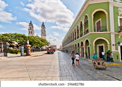 CAMPECHE, MEXICO - APRIL 19, 2014: locals and tourists in main square with Cathedral in Campeche, Mexico. The city was founded in 1540 by Spanish conquistadores atop pre-existing Maya city of Canpech
