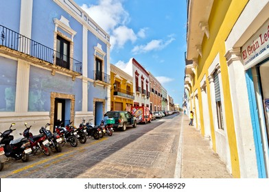 Campeche, Mexico - April 19, 2014: people, car and motorbikes in downtown street in Campeche, Mexico. The city was founded in 1540 by Spanish conquistadores atop the pre-existing Maya city of Canpech.