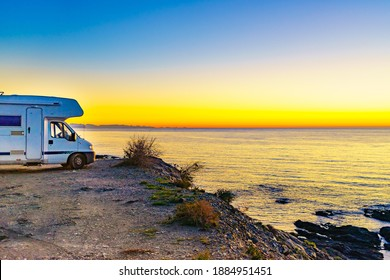 Camper car rv camping on sea shore, Spain. Adventure with motor home.