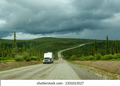 Camper on unpaved Top of the World highway in Alaska