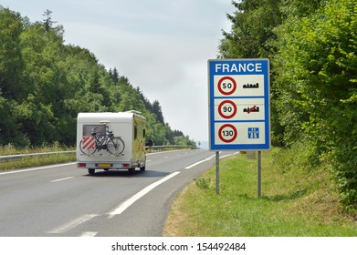 Camper passing the Sign of Speed limits at the French border