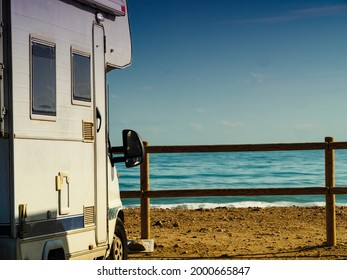 Camper rv caravan on mediterranean coast in Spain. Wild camping on nature beach. Holidays and traveling in motor home. Visiting warm winter travel destinations.