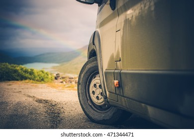 Camper and the Scenic Wild Landscape with Rainbow. Offroad Camper Driving.