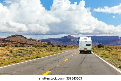 Camper trailer on Highway in USA, road trip in motorhome