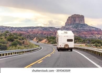 Camper trailer on Highway in USA, road trip in motorhome