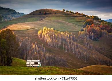 camper van in autumn landscape in Apuseni mountains, Transylvania, Romania