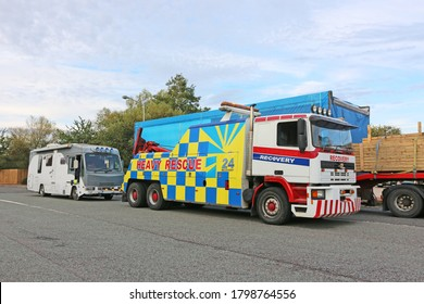 Camper Van being towed by a recovery truck
