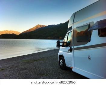 Camper van, by beautiful lake, New Zealand