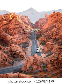 Camper van driving on scenic road through Valley of Fire state park, Nevada
