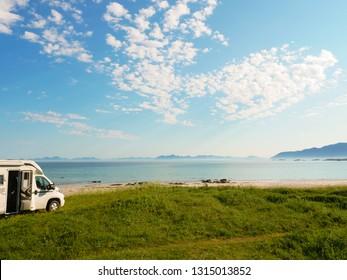 28314378bb Camper van motor home on sea coast Gimsoysand beach in summer. Camping on  ocean shore