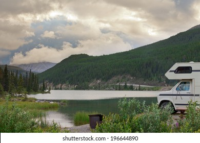 Camper van parked on Summit Lake Campground in Stone Mountain Provincial Park, highest point of the Alaska Highway, northern BC, Canada
