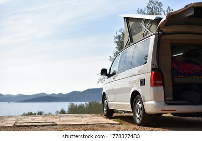 camper van is stand on camping place on sea coast