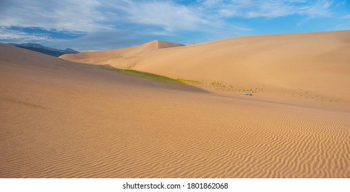 Campers Among The Giant Sand Dunes