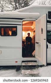 campervan caravan vehicle for van life holiday on camper van journey camping in mountains near the forest in the winter adventure season. snowing on the camper outdoor nomad lifestyle