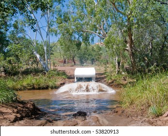 Campervan crossing deep river in Australia