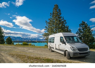 Campervan parked at the bright blue colored lake Ruataniwha