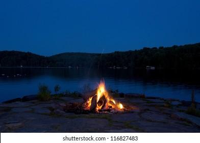 Campfire by lake at night