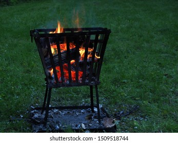 Campfire with fire basket at dusk