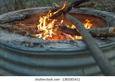 Campfire inside fire ring at Michigan state park campground.