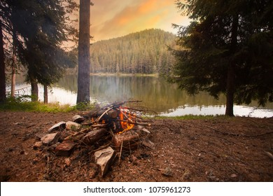 Campfire On Lakeshore, bulgarian mountains, dusk time