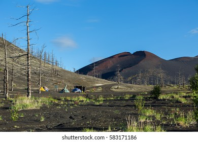 Campground near remains of a helicopter brought down and buried in the eruption of the Tolbachik volcano, Kamchatka