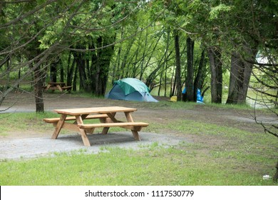 The campground site is empty