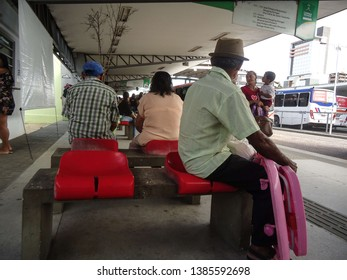 Campina Grande, Paraíba/Brazil - April 29, 2019: Old man with hat and light shirt, waiting for a bus in downtown of Campina Grande, Brazil in the morning. In April 2019.