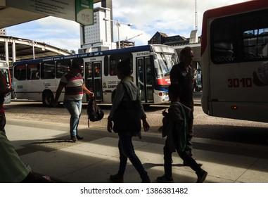 Campina Grande, Paraíba/Brazil - April 29, 2019: People walking in a bus integration inside the city of Campina Grande, Brazil in the morning.
