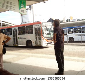 Campina Grande, Paraíba/Brazil - April 29, 2019: Man with hand on waist waiting for a bus at a bus stop in the center of Campina Grande, Brazil in the morning in April 2019.