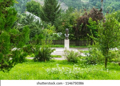 Campina, ROMANIA - July 28 2018: Monument to Marshal Alexandru Averescu in Campina. Small green park in Prahova county on a summer morning.