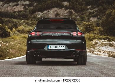 Campina, Romania - June 5 2020: Porsche Macan Turbo rear end shot, stop lights, wheel and exhaust details