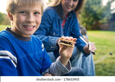 Camping: Boy Getting Ready To Eat S'mores