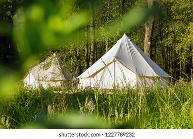 Camping canvas bell tents outdoors at forest