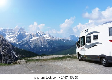 Camping car for traveling on the background of mountain dolomites, theme of outdoor activities and tourism
