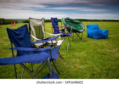 Camping chairs on a campsite