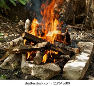 Camping Fire into Stones closeup outdoors
