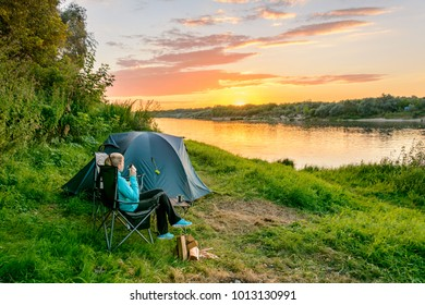 Camping in the forest. Tourist tent and equipment in the camp. Travel & Relax. Camping concept