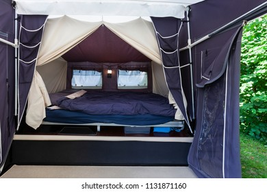 Camping or glamping with a real bed with mattress in a tent