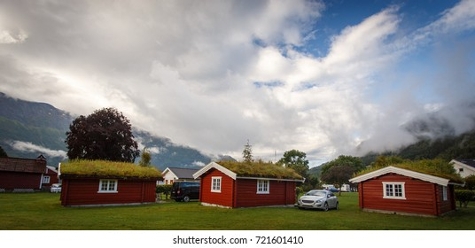 Camping houses in Norway with clouds and mountains