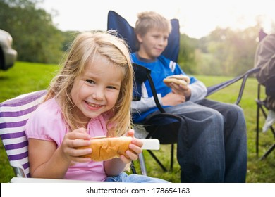 Camping: Hungry Little Girl With Hot Dog