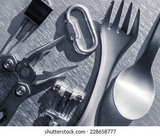 camping items on a steel background